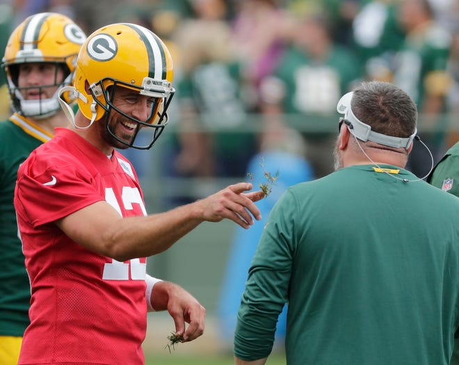 Green Bay Packers quarterback Aaron Rodgers (12) tosses some grass during training camp practice at Ray Nitschke Field on Thursday, July 26, 2018 in Ashwaubenon, Wis. Adam Wesley/USA TODAY NETWORK-Wisconsin
