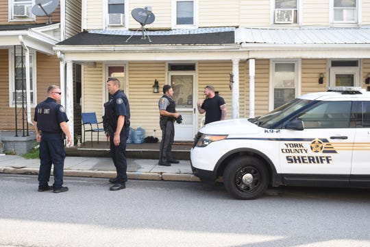 Police investigating a shooting on Fulton Street.