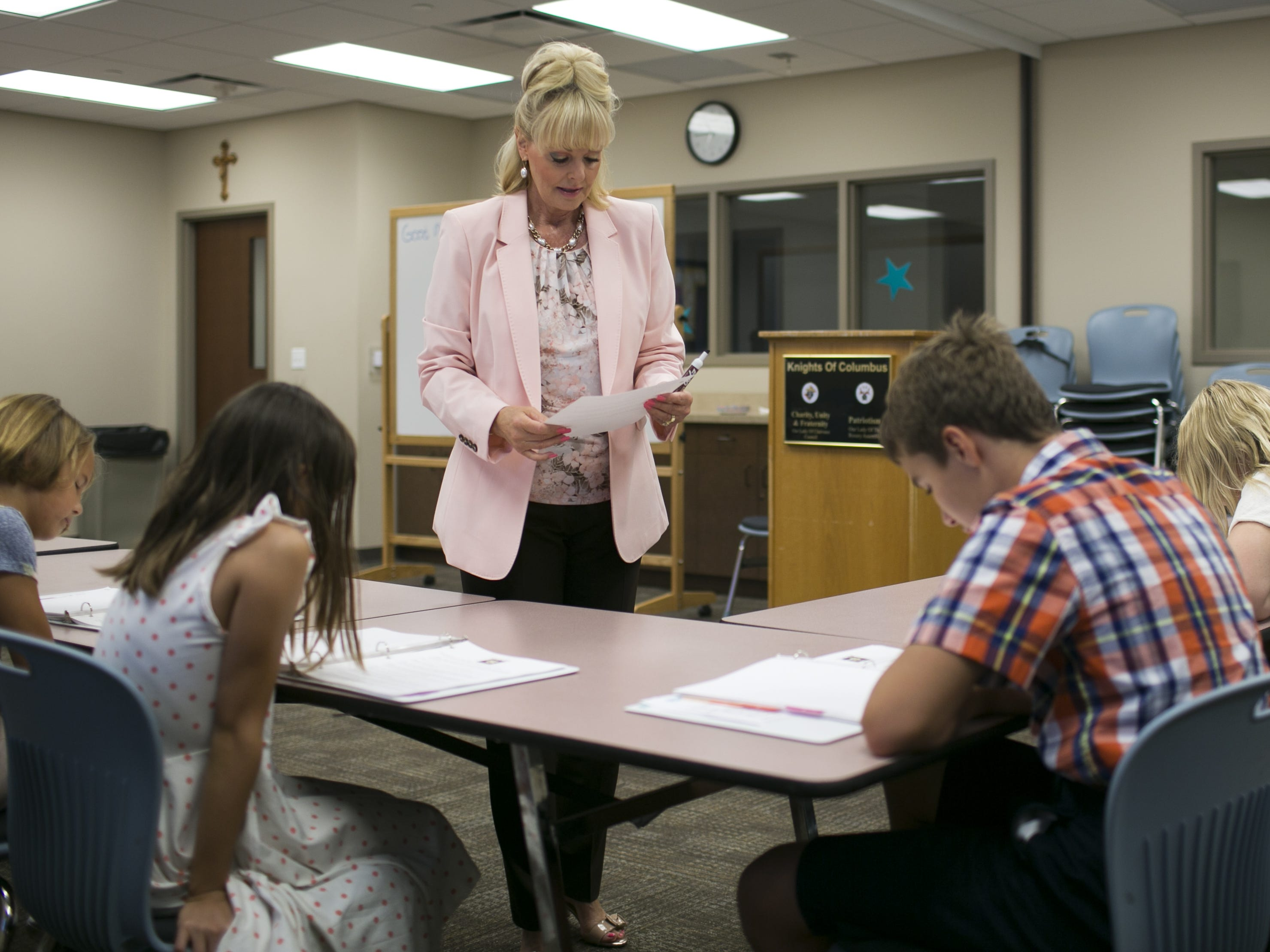 SueAnn Brown, center, teaches an etiquette class to kids ages 9-13 at the St. Bernard of Clairvaux Church in Scottsdale on July 20, 2018.  Brown started the program with the aim to teach kids, adults and companies on proper manners and social etiquette.