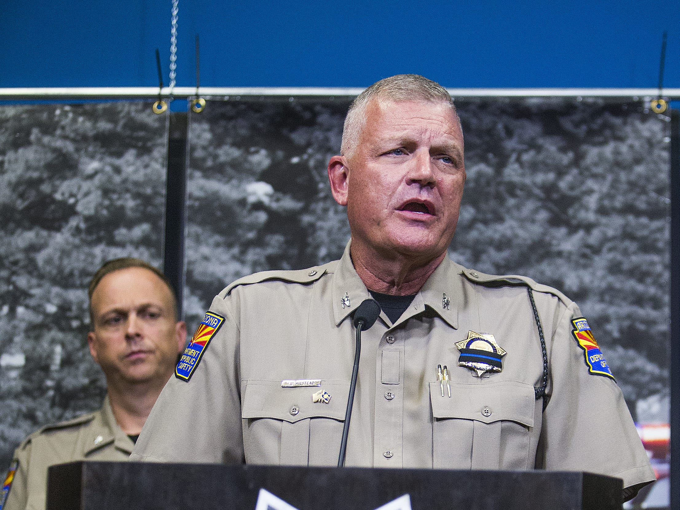 Col. Frank Milstead, director of the Arizona Department of Public Safety in Phoenix, answers questions from the media during a press conference, on July 26, 2018, regarding the death of DPS trooper Tyler Edenhofer.