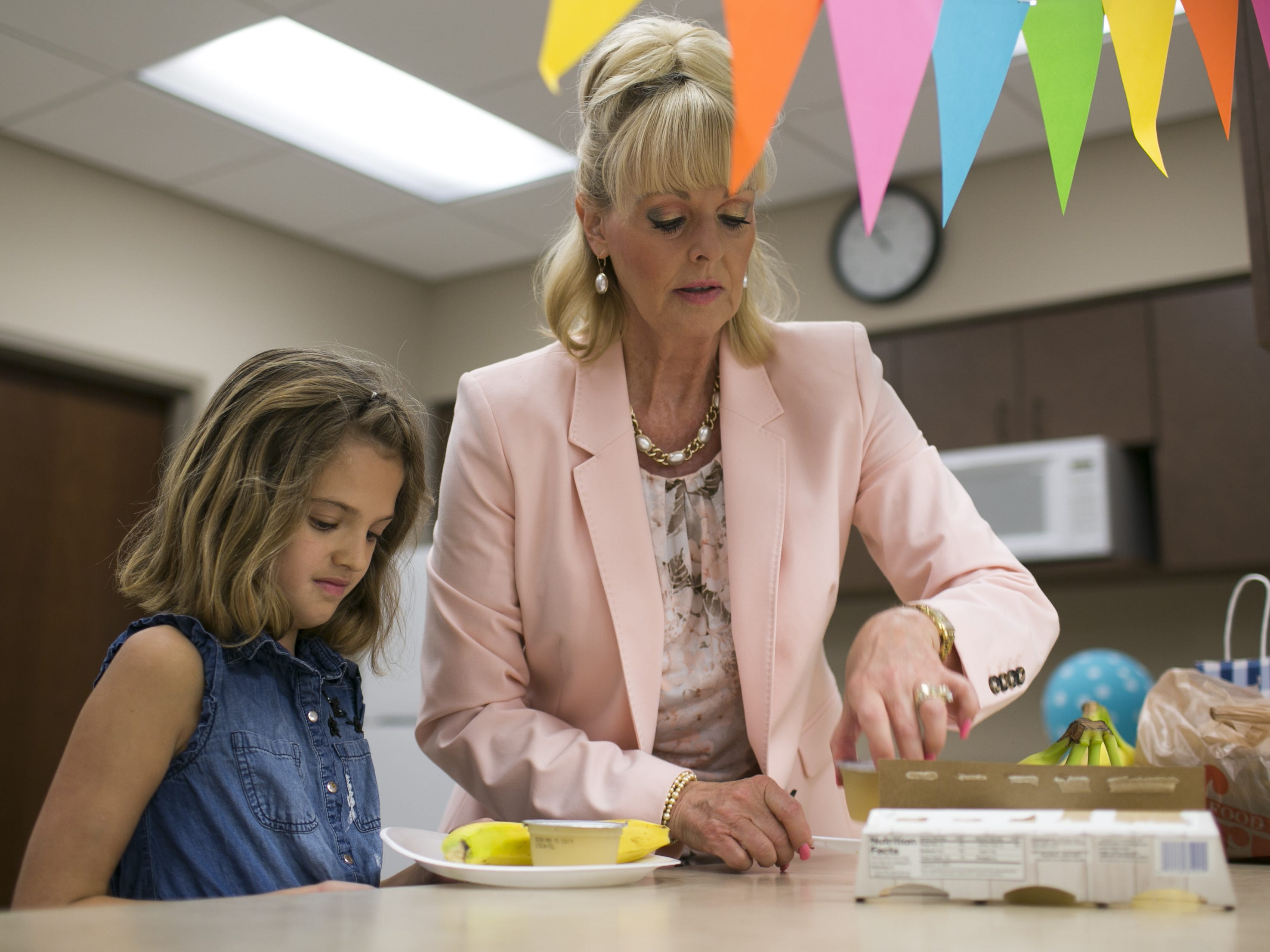SueAnn Brown, right, teaches an etiquette class to kids ages 9-13 at the St. Bernard of Clairvaux Church in Scottsdale on July 20, 2018. Brown started the program with the aim to teach kids, adults and companies on proper manners and social etiquette.