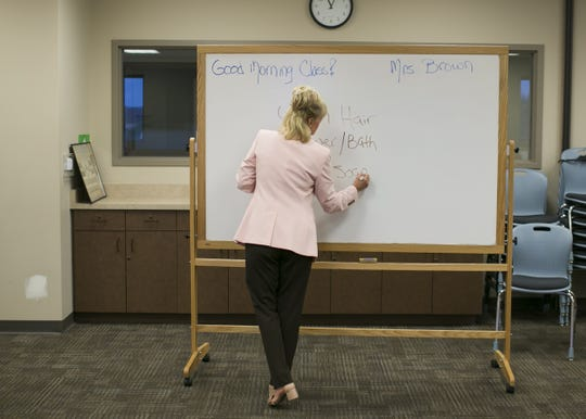 SueAnn Brown teaches an etiquette class to kids ages 9-13 at the St. Bernard of Clairvaux Church in Scottsdale on July 20, 2018.  Brown started the program with the aim to teach kids, adults and companies on proper manners and social etiquette.