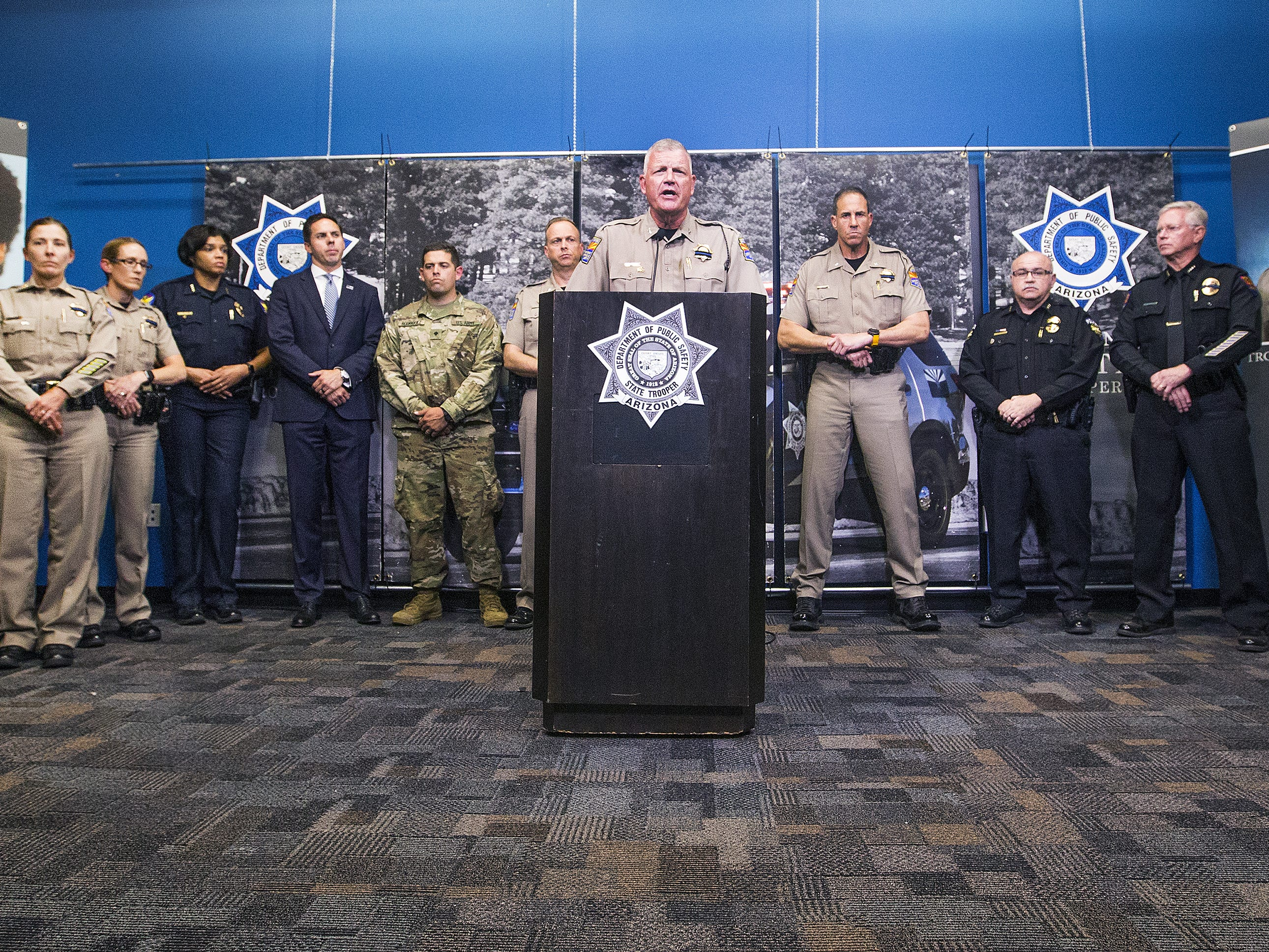 Col. Frank Milstead, director of the Arizona Department of Public Safety in Phoenix, answers questions from the media during a press conference, Thursday, July 26, 2018, regarding the death of DPS trooper Tyler Edenhofer.