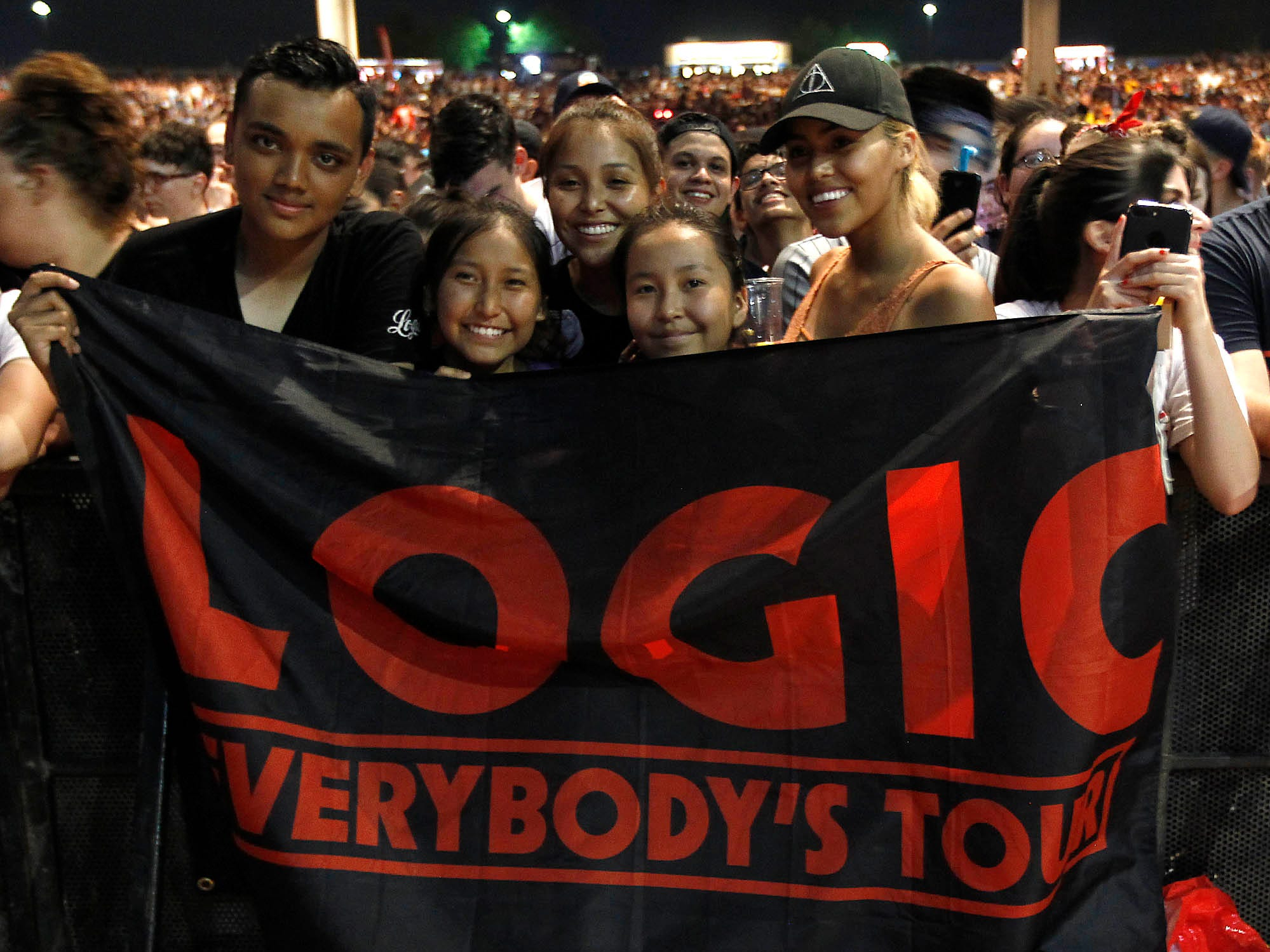 Fans hold up a Logic banner during his Bobby Tarantino vs Everybody Tour at Ak-Chin Pavilion in Phoenix on Wednesday, July 25, 2018.