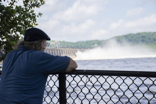 Water rushing through the open gates of the Conowingo Dam in Darlington, Maryland.