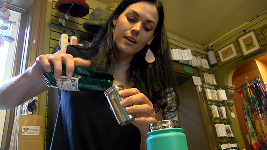 Amanda Axe of Cherie Anne Designs demonstrates how to use a tea diffuser thermos.