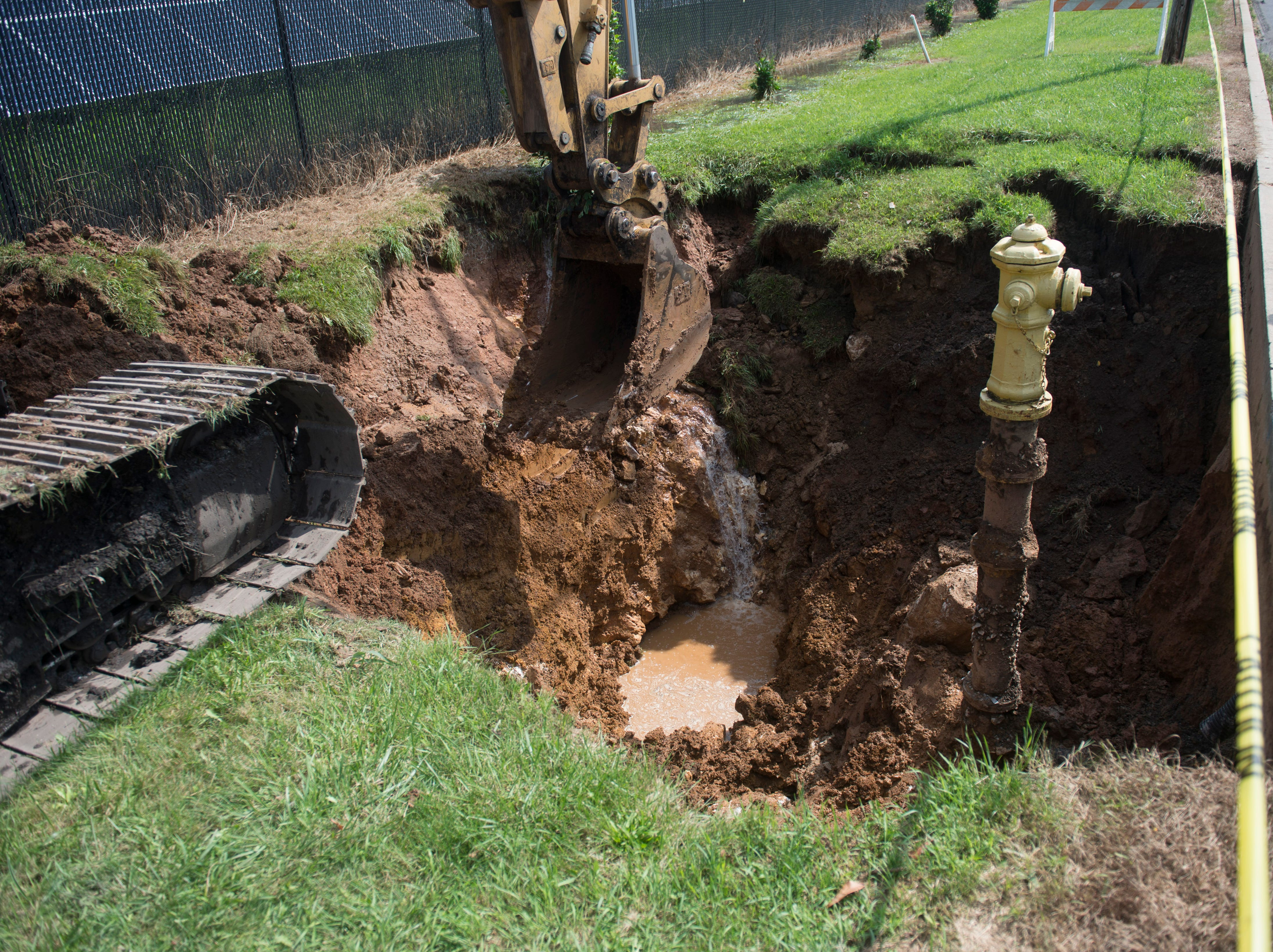 A sink hole, over 10 feet deep, opened up alongside Route 30 in Thomasville on July 26, 2018.