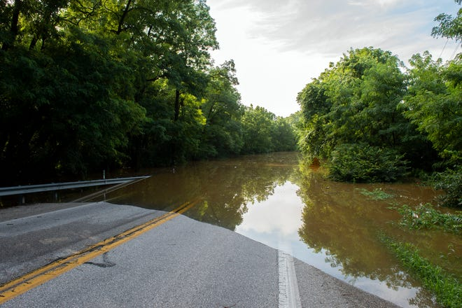Flooding emerges 616 South, Thursday, July 26, 2018. Heavy rains poured on the region, closing multiple roads around the county and causing hazards.