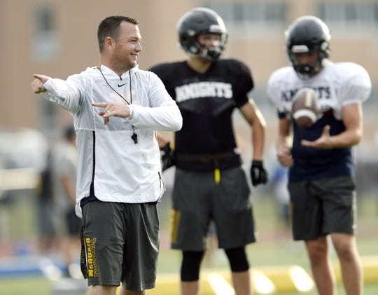 McQuaid head coach Bobby Bates explains a play during a combined summer minicamp with the Irondequoit Eagles at McQuaid Jesuit High School on Wednesday, July 25, 2018.