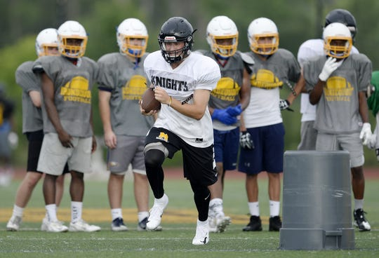 McQuaid's Ben Beauchamp participates in drills during a combined summer minicamp with the Irondequoit Eagles at McQuaid Jesuit High School on Wednesday, July 25, 2018.