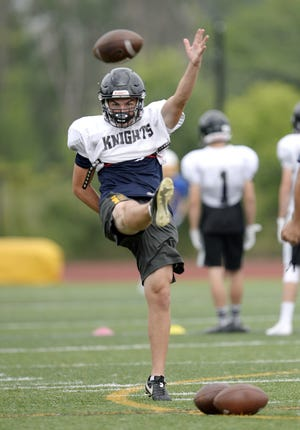 McQuaid punter Jared Campbell works out during a combined summer minicamp with the Irondequoit Eagles at McQuaid Jesuit High School on Wednesday, July 25, 2018.