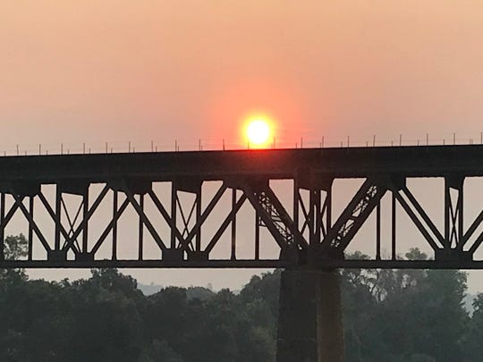 The sunrise on Thursday, July 26, 2018 in Redding is orange as the Carr Fire grows larger.