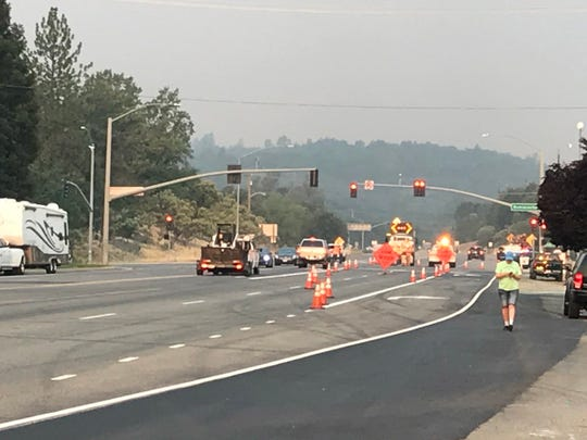 Authorities on Thursday, July 26, 2018 shut down traffic on Highway 299 at Buenaventura Boulevard in Redding as the Carr Fire continued to push east.