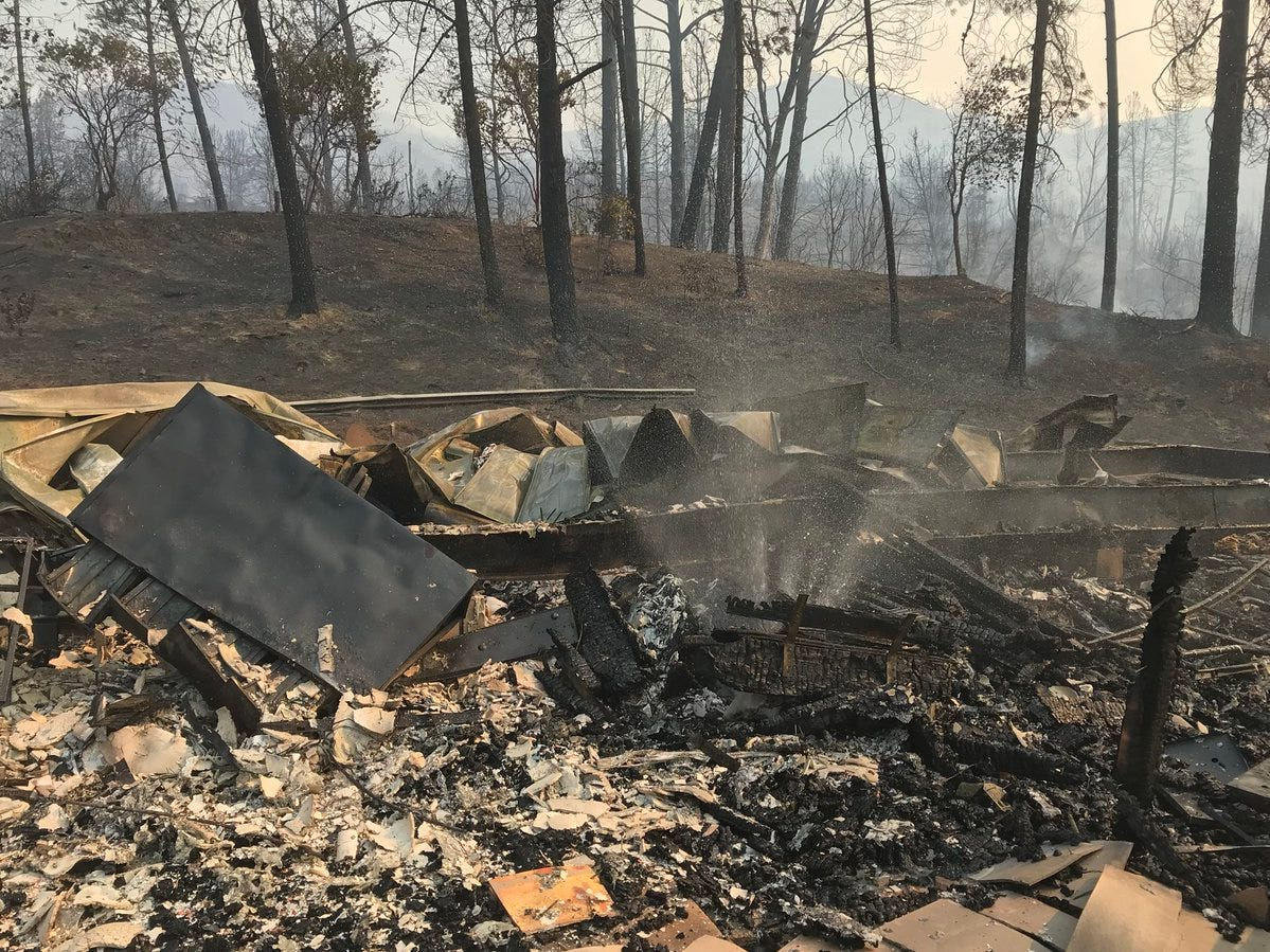 The Carr Fire on Thursday, July 26, 2018 reduced to ashes and rubbles a building in the Oak Bottom Marina.