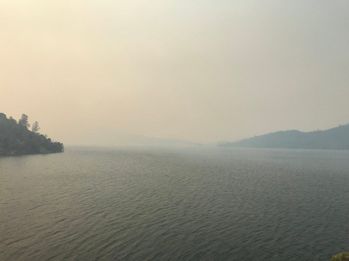 Whiskeytown Lake is hardly visible on Thursday, Jul;y 26, 2018 because of smoke from the Carr Fire.