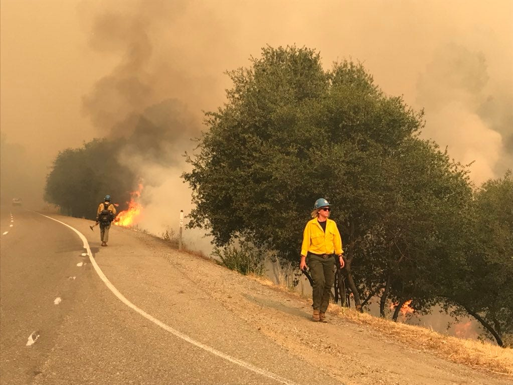 Firefighters monitor on Thursday morning the Carr Fire near Iron Mountain Road in the Keswick area.