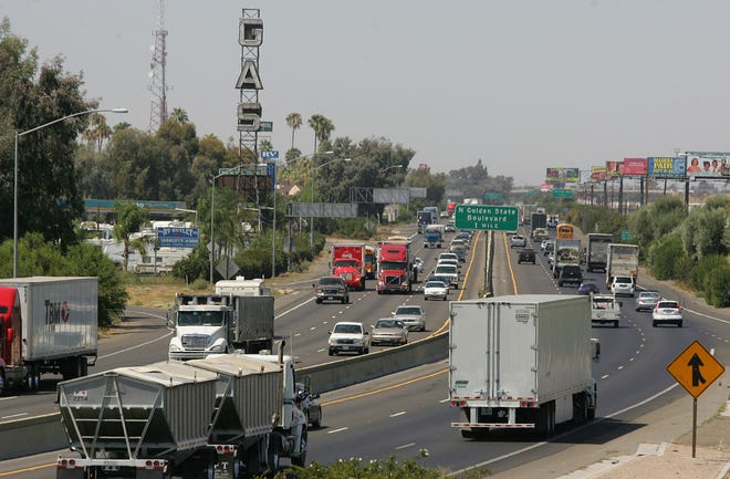 In this file photo, a stretch of the Highway 99 corridor is shown busy with traffic in Fresno.