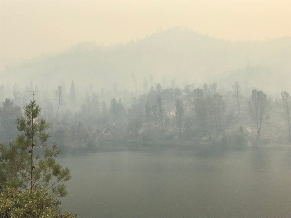 Whiskeytown Lake is hardly visible on Thursday, July 26, 2018 because of smoke from the Carr Fire.