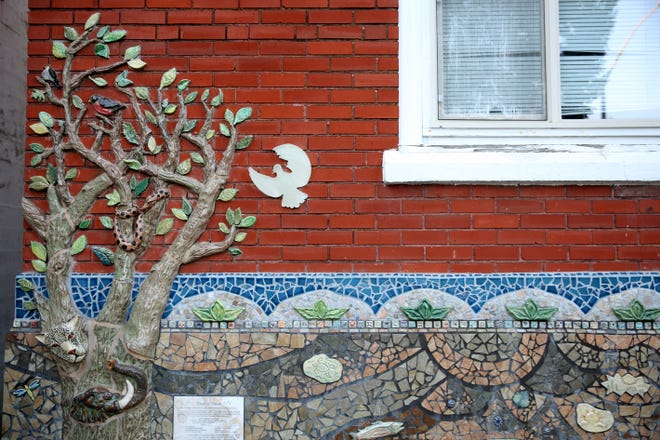 The community is being encouraged to help save the Salem Peace Mosaic, created around the entrance to the Salem YMCA building, which is slated for demolition in February.