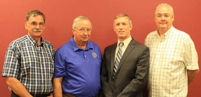 Worcester County Commissioner Ted Elder, left, Somerset County Commissioner Randy Laird, second from left, and Worcester County Commissioner Joe Mitrecic, far right, pose with Gregory Padgham who has been named as the new executive director of the Tri-County Council.
