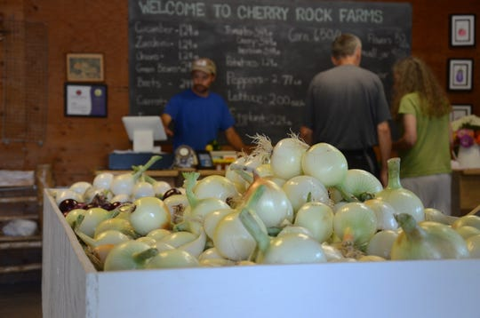 Marco Picasso helps customers at Cherry Rock Farms.