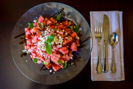 A watermelon feta salad with roasted pecans and fresh mint at J. Graham's Cafe at the Brown Hotel in downtown Louisville on Wednesday, July 18, 2018.