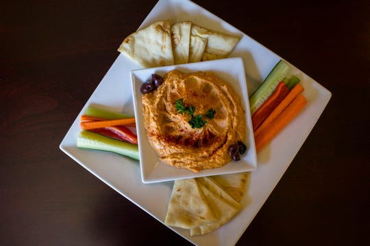 Smoked red pepper hummus at J. Graham's Cafe at the Brown Hotel in downtown Louisville on Wednesday, July 18, 2018.