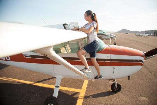 Ha'aheo Carpenter prepares July 26, 2018, at the St. George Municipal for one of her final flights before earning her pilot's license.