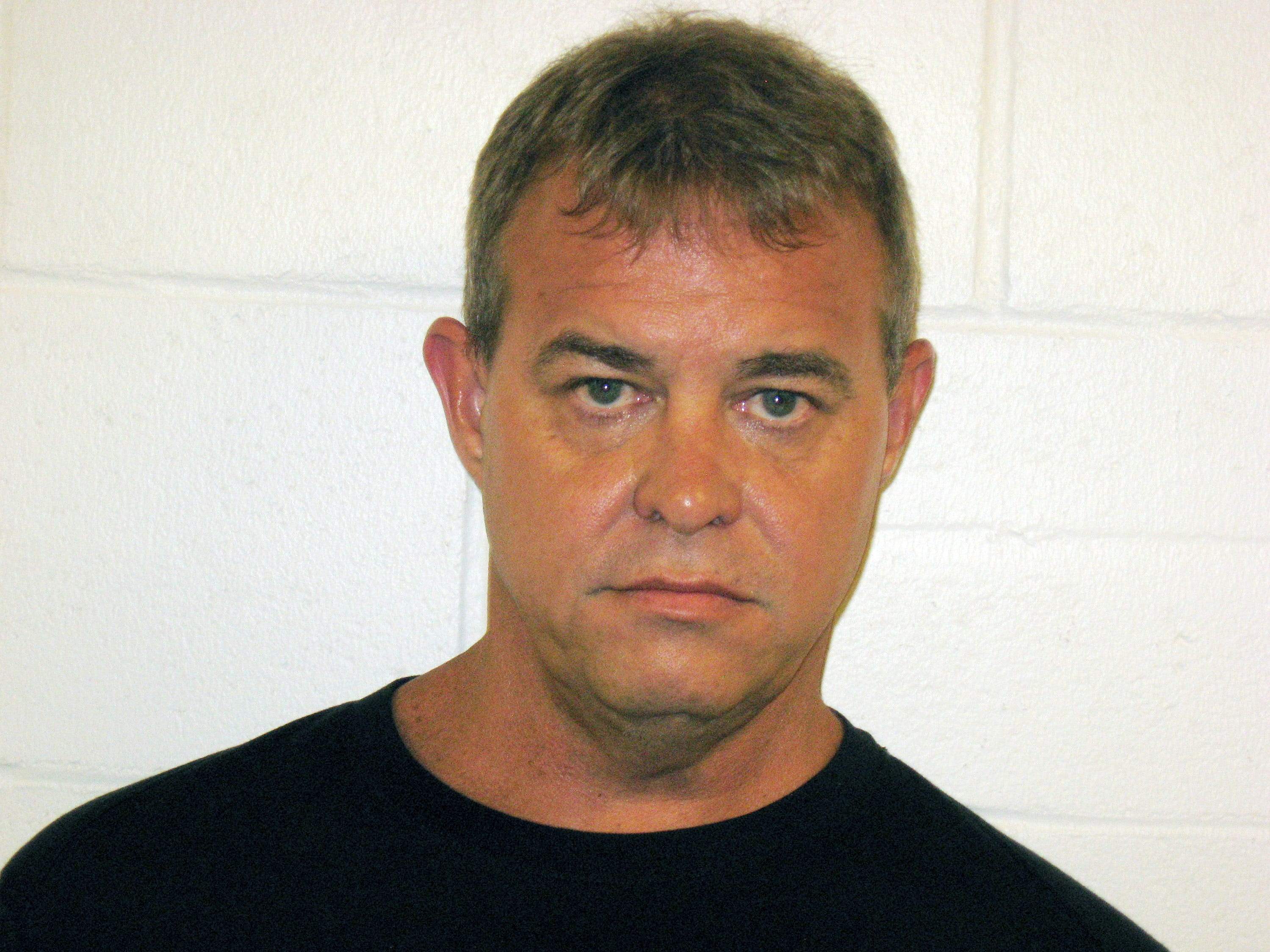 This undated file photo provided by the Churchill County Sheriff's office shows John O'Conner. The Nevada man accused of fatally shooting a fellow member of his Mormon congregation during Sunday services made his first court appearance Wednesday, July 25, 2018, after being indicted on murder, battery and assault charges.
