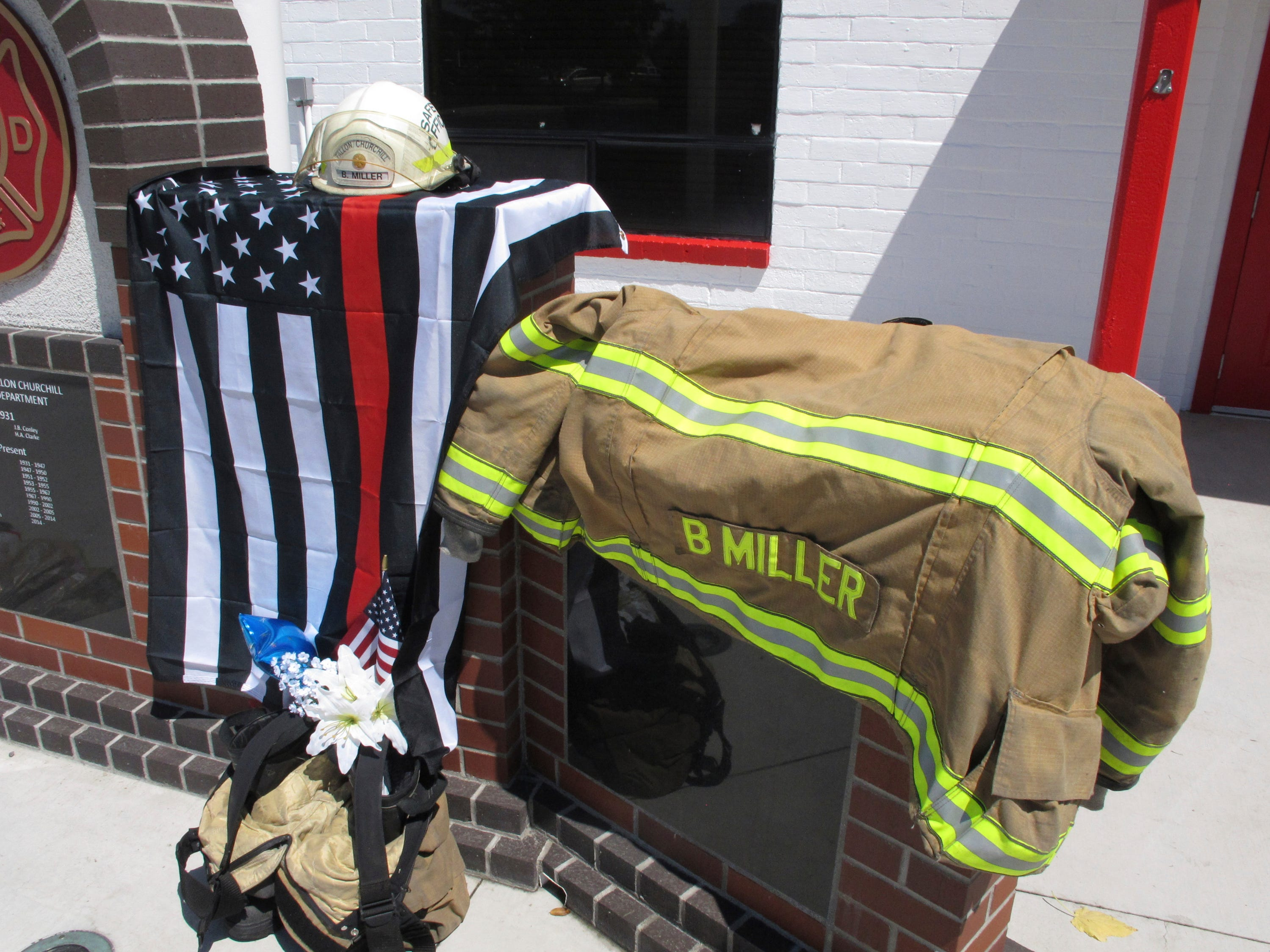 "The equipment of Charles E. ""Bert"" Miller, 61, who was fatally shot the day before during Sunday services at his local Mormon church, is pictured at a makeshift memorial outside the rural Nevada fire station where the longtime volunteer firefighter worked, Monday, July 23, 2018, in Fallon, Nevada."