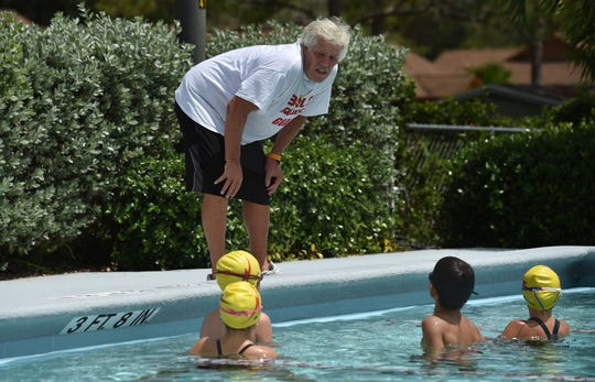 Bill Bolton, of Vero Beach, helps coach young student swimmers at the Leisure Square pool on Thursday, July 26, 2018, in Vero Beach. Bolton jumped into action to help a woman who flipped her car into a water-filed ditch in the 5000 block of 85th Street Wednesday evening and helped with her rescue.