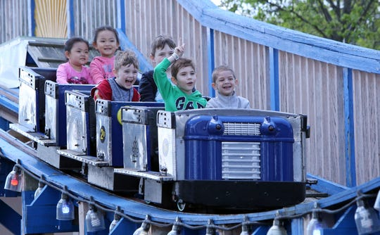 Children ride the Kiddy Coaster on opening day at Playland on Mother's Day, May 14, 2017 in Rye.