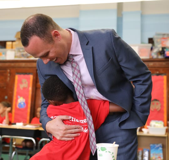 Daniel Russ, principal of PS 294, The Walton Avenue School in the Bronx interacts with summer program students  on Thursday, July 26, 2018.