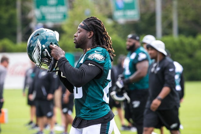 Eagles running back Jay Ajayi puts on his helmet as he joins his teammates for warm up drills as the Super Bowl Champions Philadelphia Eagles begin their first practice of training camp at the NovaCare Complex in Philadelphia.