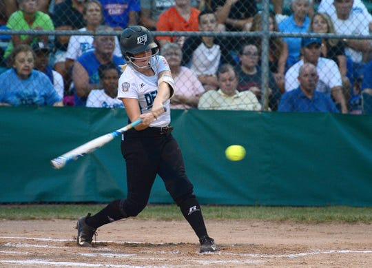 Delaware District III's Corrin Farris gets a hit against Southwest during the Senior League World Series last August in Roxana. Farris and her Georgetown team are back to defend their title starting Monday.