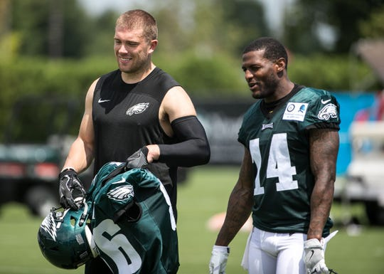 Eagles tight end Zach Ertz and wide receiver Mike Wallace walk off the field after practice. The Super Bowl Champions Philadelphia Eagles begin their first practice of training camp at the NovaCare Complex in Philadelphia.