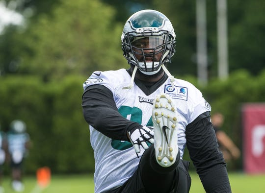 Eagles defensive tackle Fletcher Cox does warmup drills with his teammates as the Super Bowl Champions Philadelphia Eagles begin their first practice of training camp at the NovaCare Complex in Philadelphia.