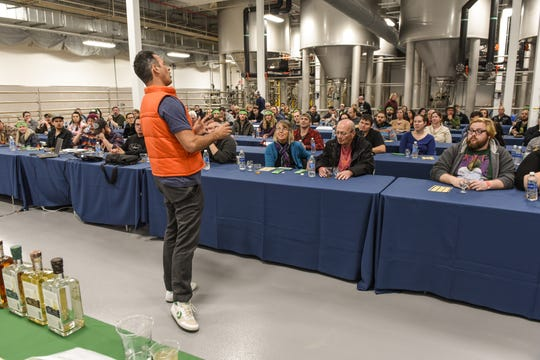 Dogfish Head founder Sam Calagione speaks to a crowd at his Milton brewery during Weekend of Compelling Ales & Whatnot in March.