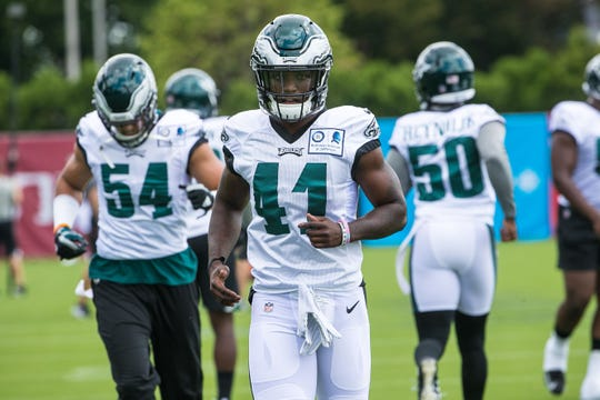 Eagles safety Jeremy Reaves does warm up drills with his teammates as the Super Bowl Champions Philadelphia Eagles begin their first practice of training camp at the NovaCare Complex in Philadelphia.