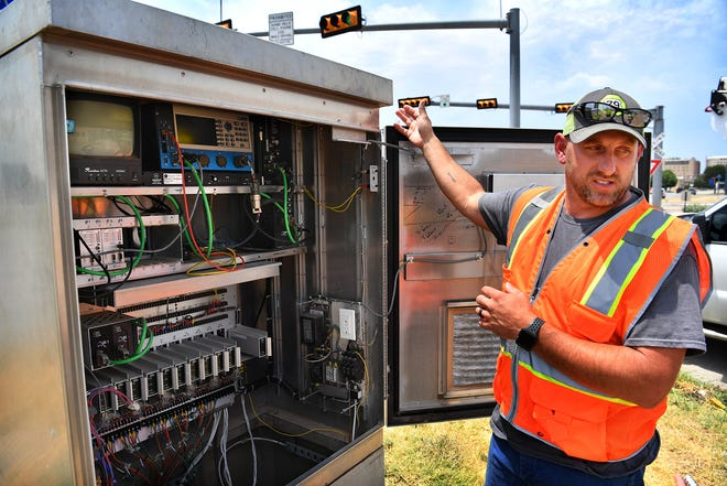 Eric Stevens, lead traffic technician for the City of Wichita Falls, explains the function of a new traffic control monitoring system which allows remote monitoring of the 101 intersections regulated with traffic lights.