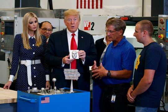 President Donald Trump participates in a tour of an advanced manufacturing lab with Ivanka Trump, left, and Gov. Kim Reynolds, R-Iowa, third from right, at Northeast Iowa Community College, Thursday, July 26, 2018, in Peosta, Iowa.