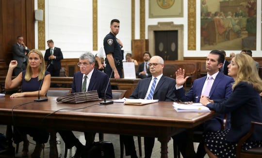 Vanessa Trump, left, and Donald Trump Jr., second from right, participate in a hearing in their divorce case in New York, Thursday, July 26, 2018.
