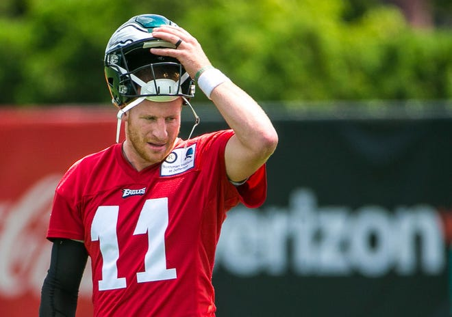 Philadelphia Eagles quarterback Carson Wentz warms up on the field during training camp at the NovaCare Complex.
