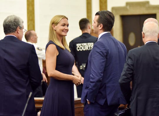 Vanessa Trump talks with Donald Trump Jr. after a hearing in their divorce case in New York, Thursday, July 26, 2018.