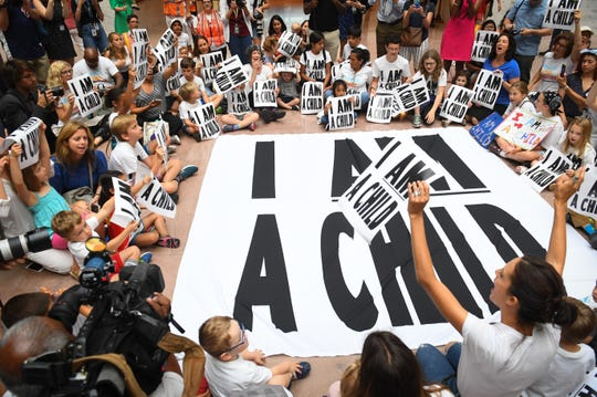 Protesters at the reunification rally sing songs at the Senate Hart Office Building on July 26, 2018.