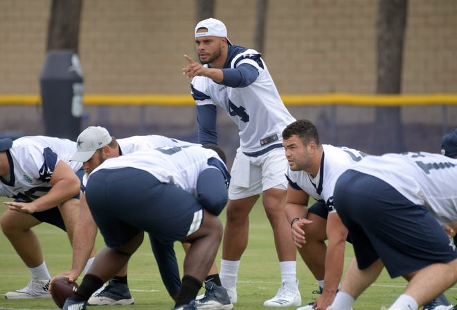 Dallas Cowboys quarterback Dak Prescott (4) gestures  during training camp at River Ridge Fields.