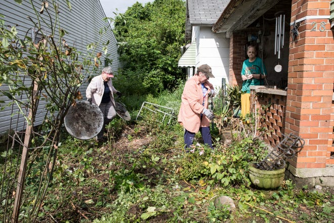 As part of the Stronger Ross County effort, volunteers from the new The Neighborhood Place organization spent part of their day Friday helping to clean up the yard of Rita Skaggs, who has not been able to do the yard work herself due to health issues.