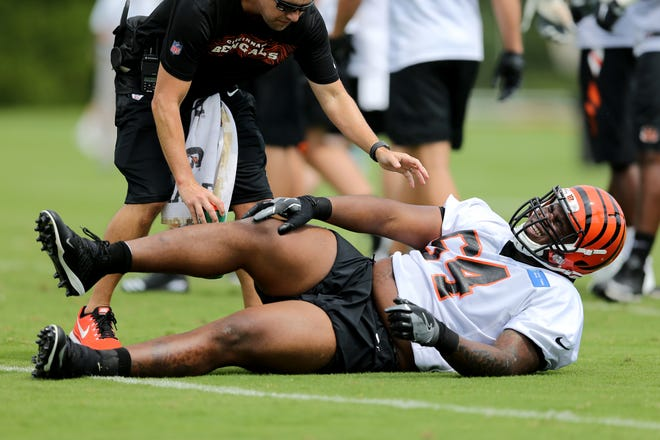 Cincinnati Bengals offensive tackle Rod Taylor (64) is injured during Cincinnati Bengals training camp on the practice fields next to Paul Brown Stadium, Thursday, July 26, 2018, in Cincinnati.