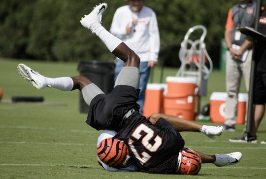 Cincinnati Bengals defensive back Dre Kirkpatrick (27) fights for an interception during Cincinnati Bengals training camp on the practice fields next to Paul Brown Stadium, Friday, July 27, 2018, in Cincinnati.