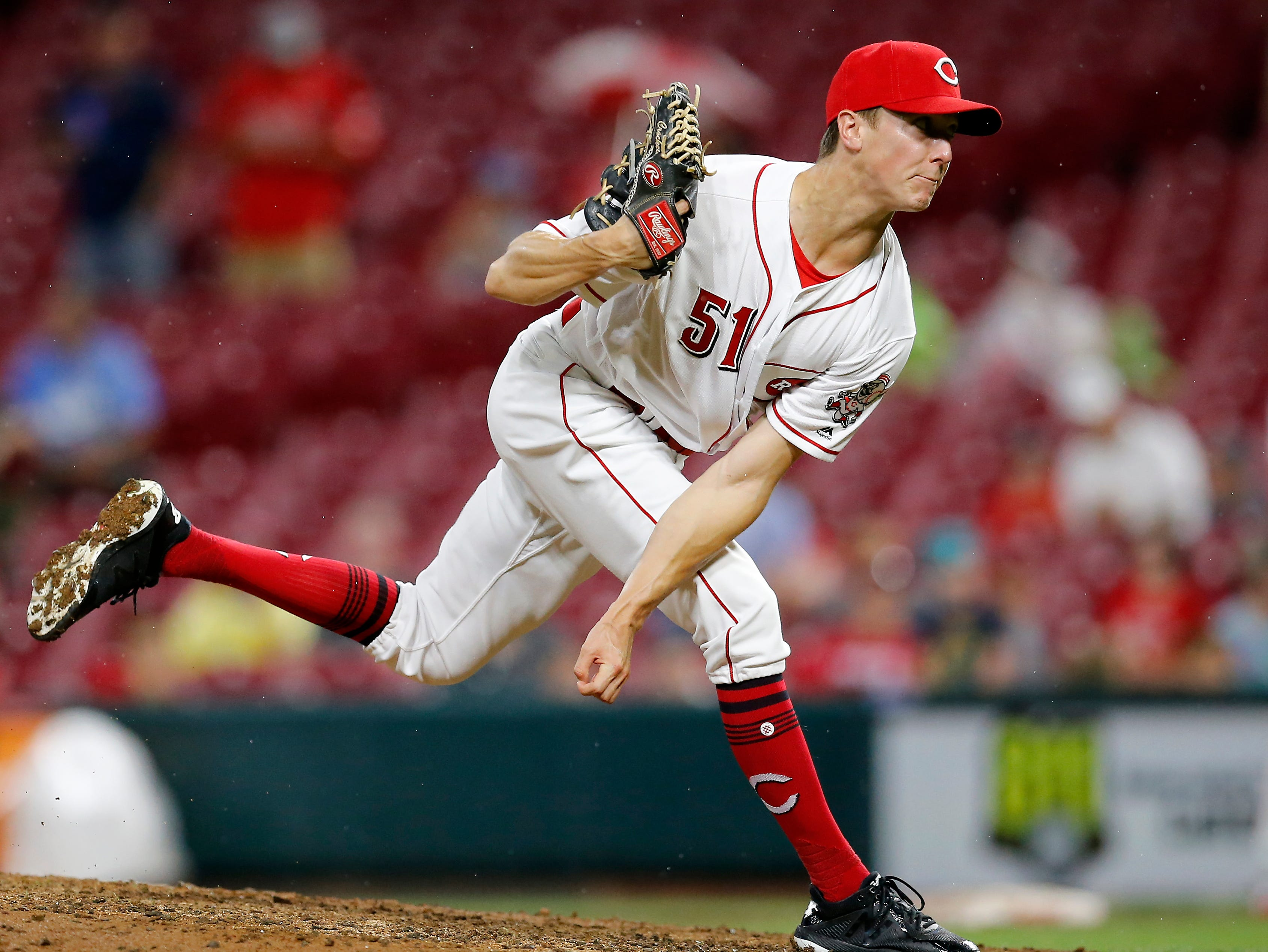 Cincinnati Reds relief pitcher Kyle Crockett (51) followers through on a pitch in the top of the eighth inning of the MLB National League game between the Cincinnati Reds and the Philadelphia Phillies at Great American Ball Park in downtown Cincinnati on Thursday, July 26, 2018. The Reds lost 9-4.